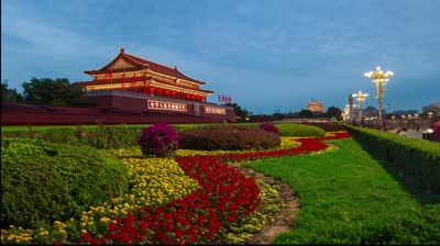 stock-footage-from-day-to-night-the-splendid-tian-anmen-tower-and-the-colorful-flower-bed-in-beijing-china